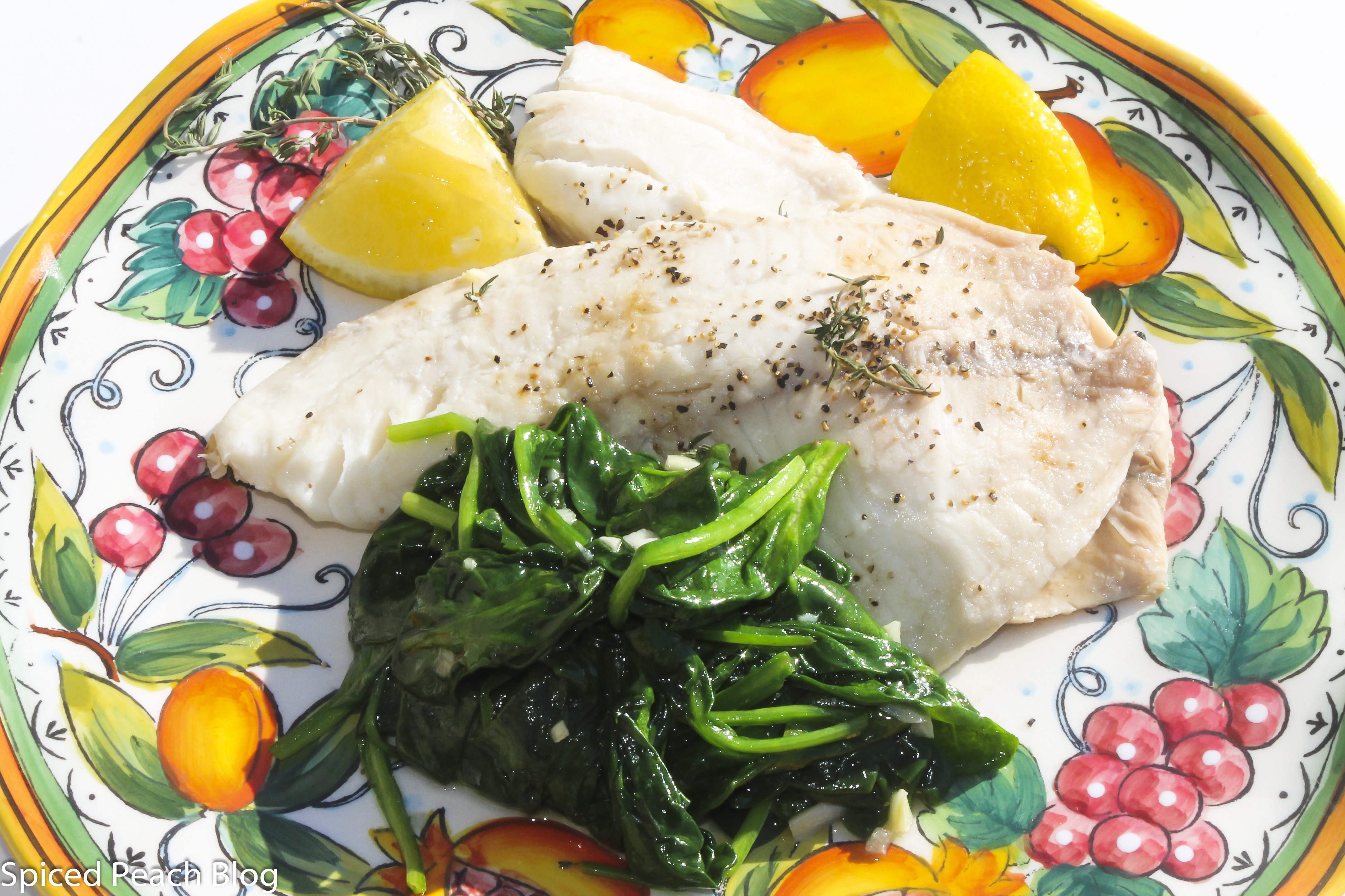 Tilapia En Papilotte with fresh herbs, white wine and onions