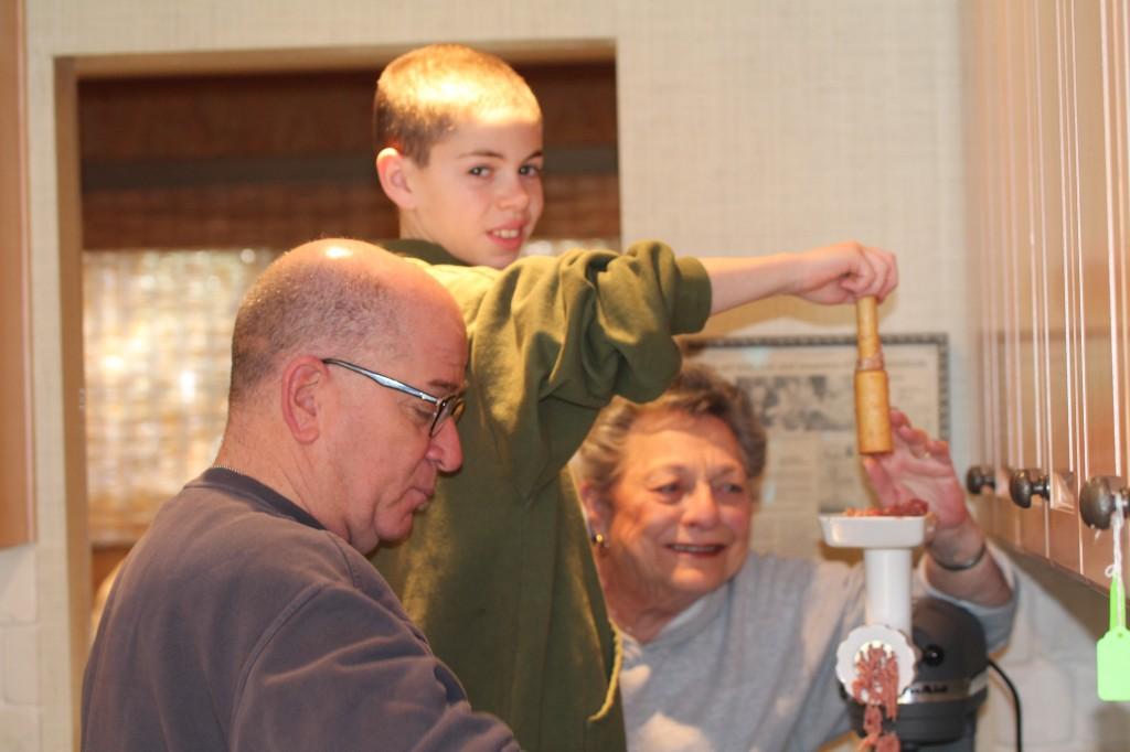 Flossie, Glen and Noah grinding fresh fish Preparing Gefilte