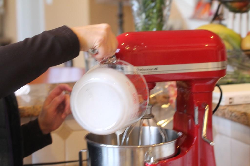pour heavy whipping cream into mixer