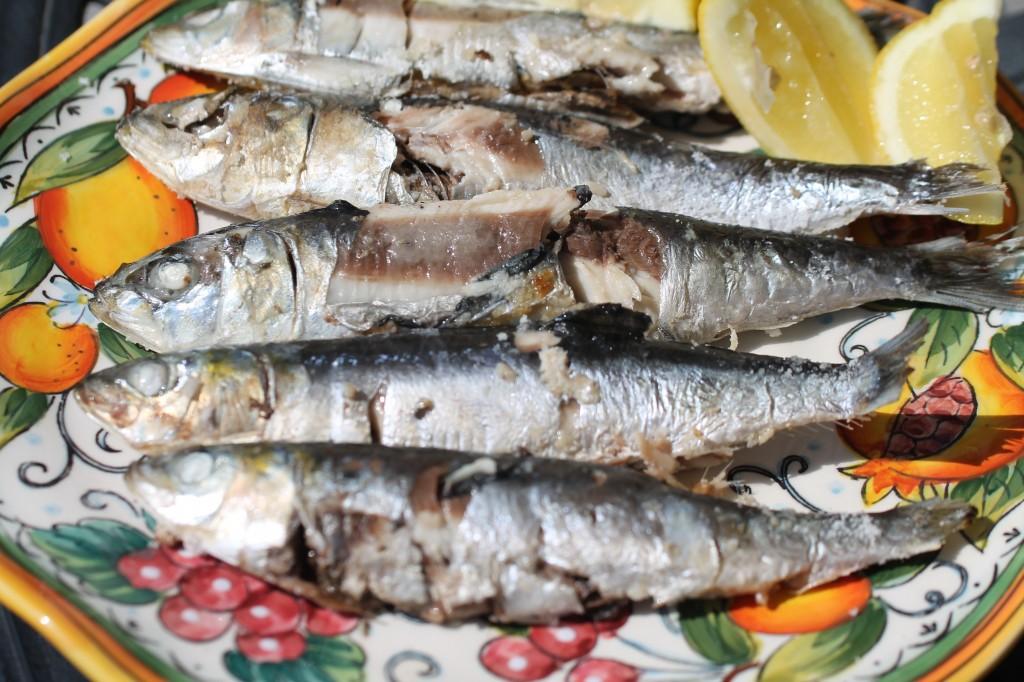 Grilled Sardines on Sea Salt with Lemons