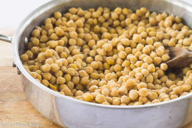 soaked chick peas in a skillet ready for cooking