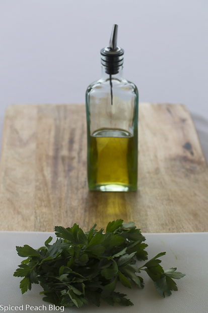 olive oil in bottle with fresh parsley