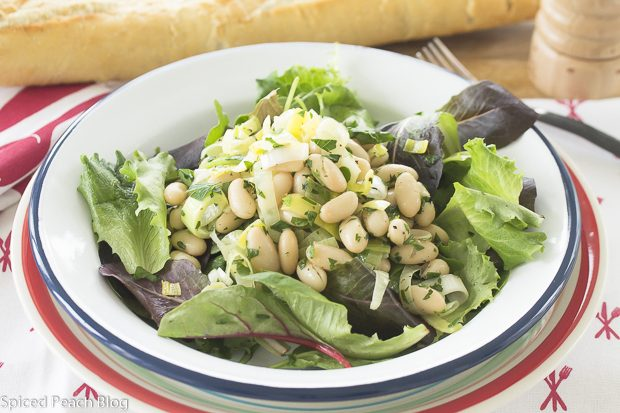 white bean salad on greens