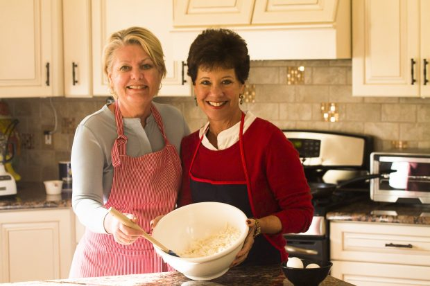 Karen and Peggy preparing Latkes