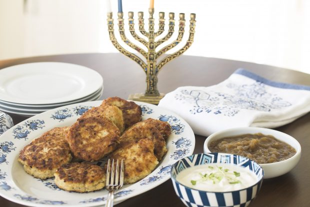 Latkes, sour cream, applesauce and menorah