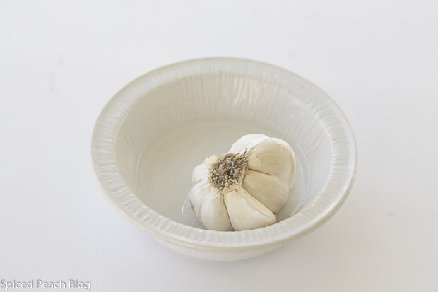 head of garlic in dish for roasting