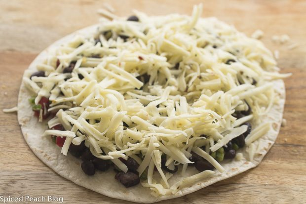 Black Bean Mixture topped with Pepper Jack Cheese on Tortilla
